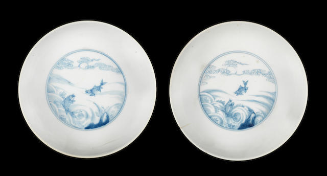 A pair of blue and white 'fish' dishes Yongzheng six-character marks and of the period