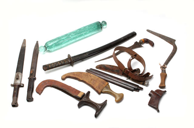 A collection of various weapons and bayonets
