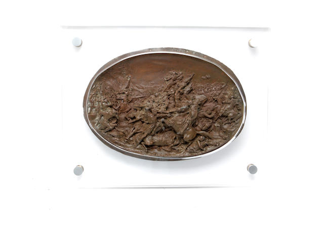 An oval bronzed spelter plaque