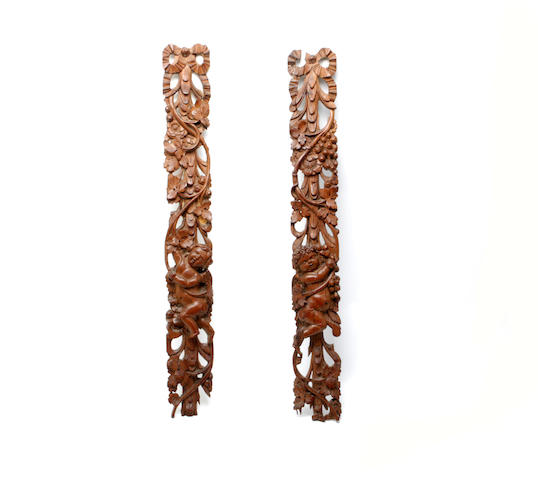 A pair of carved walnut mountsProbably French and 19th century