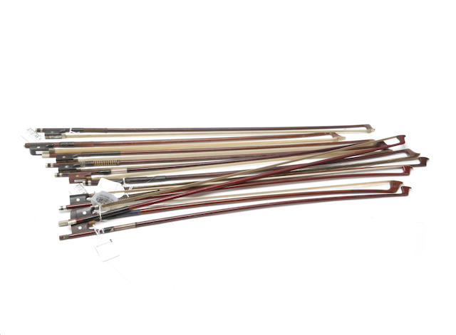 A collection of eight violin bows and three cello bows,