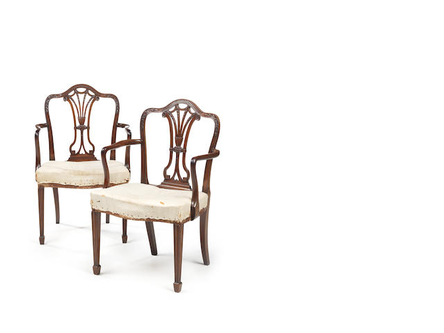 A pair of George III carved mahogany armchairs  in the manner of John Linnell