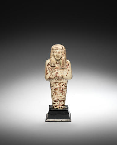 An Egyptian white glazed composition shabti
