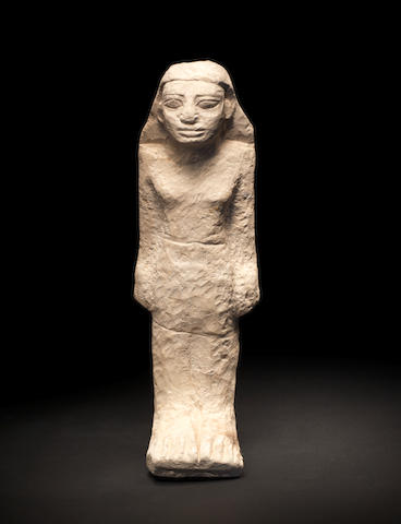 An Egyptian limestone figure of a man