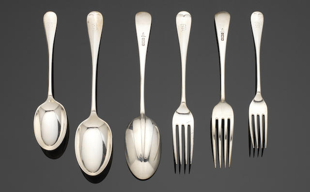 An Edwardian silver Hanoverian pattern table service of flatware by Walker & Hall, predominately Sheffield 1903