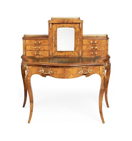 A mid Victorian walnut bonheur du jour  in the Louis XV style