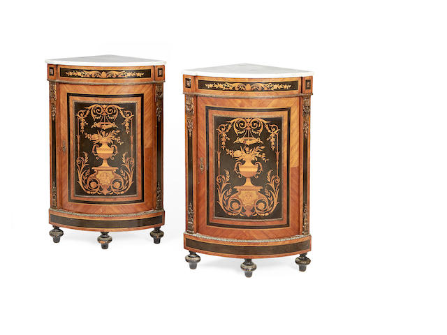 A pair of French late 19th/early 20th century tulipwood, ebony and fruitwood marquetry encoignures in the Louis XVI style