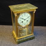An early 20th Century green onyx four glass mantel clock including key
