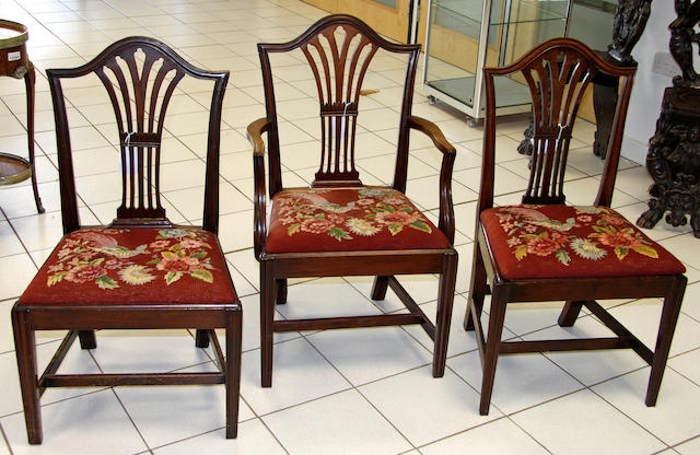 A set of eight Georgian mahogany dining chairs