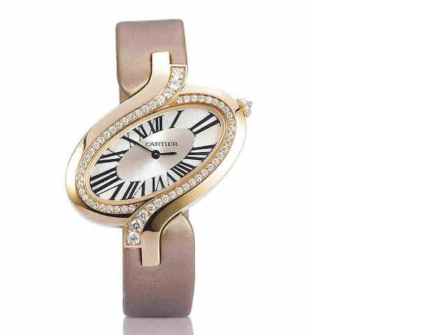 A gold and diamond 'Délices de Cartier' wristwatch, by Cartier