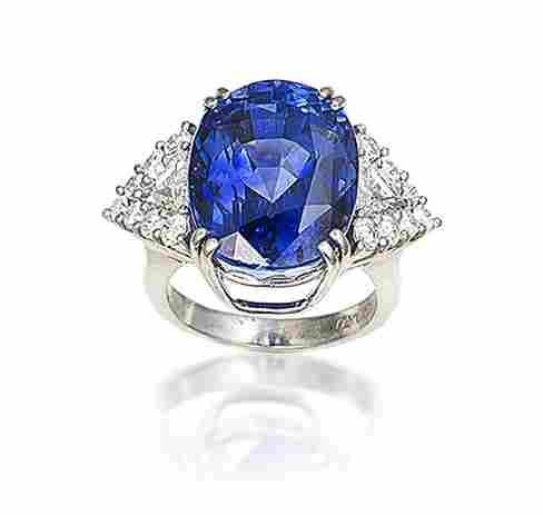 A sapphire and diamond ring, by Garrard (with 2 certificates)