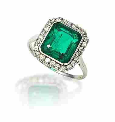 An emerald and diamond dress ring,