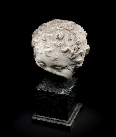 A Roman marble fragmentary head of a boy
