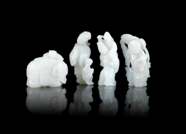 A group of four jade carvings