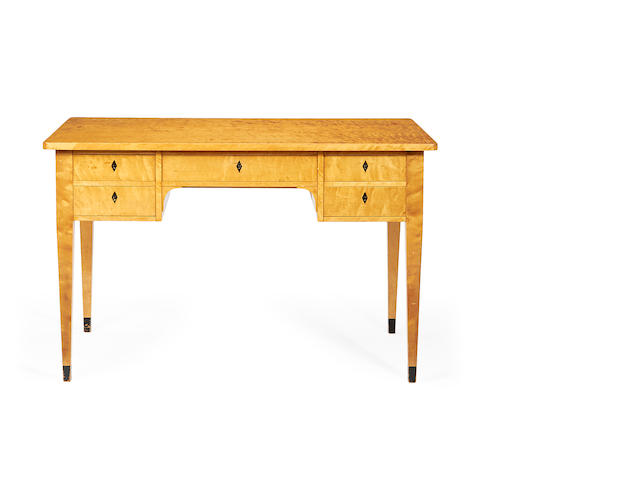 An early 20th century Biedermeier revival satinbirch kneehole table