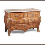 A Louis XV gilt metal mounted kingwood and rosewood bombé serpentine commode