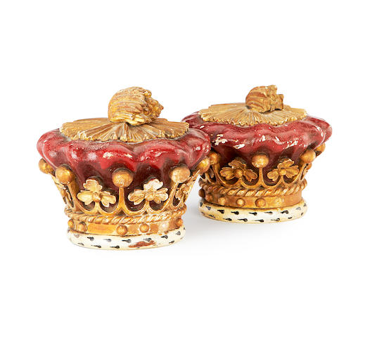 A pair of late 19th / early 20th century painted and giltwood crown finials