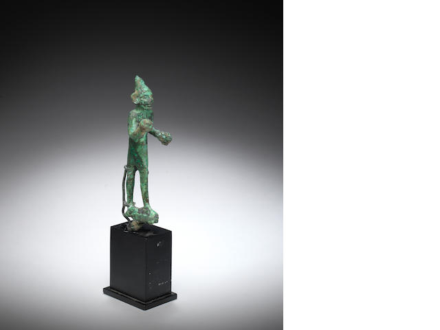 A Canaanite bronze striding male figure