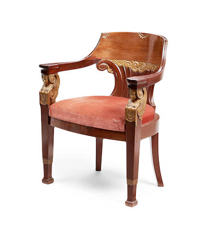 A Baltic late 19th/early 20th century mahogany and parcel gilt tub back armchair in the Empire style
