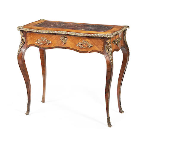 A small early Victorian gilt metal mounted rosewood and tulipwood serpentine writing table in the Louis XV style