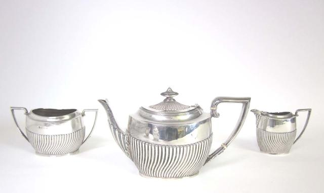 An Edwardian silver three-piece tea set maker's mark S.G, Birmingham 1902