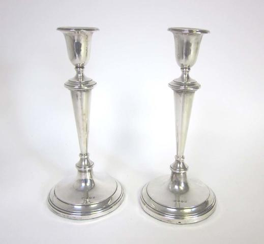 A pair of silver candlesticks by Mappin & Webb, Birmingham 1925