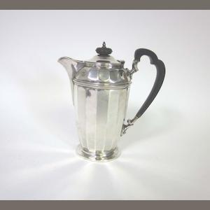 A silver hot water pot by Frank Cobb & Co Ltd, Sheffield, date letter rubbed together with a silver shaped-circular salver, maker's mark A C & Ss Ltd, London 1973 (2)