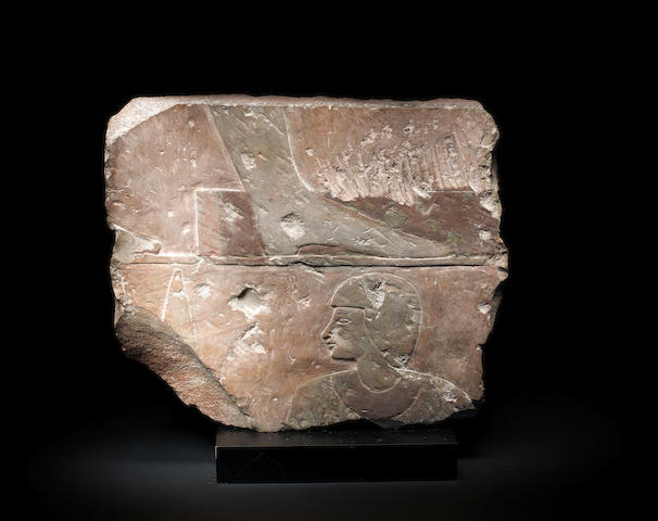 An Egyptian pink limestone relief fragment