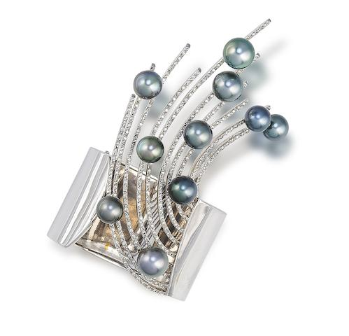 A cultured pearl and diamond cuff bracelet