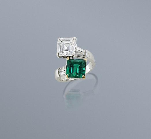 An emerald and diamond crossover ring