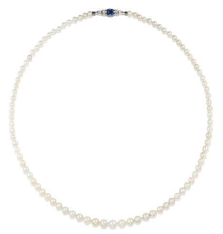 A pearl and cultured pearl necklace with sapphire and diamond clasp