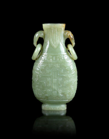 A green jade pear-shaped vase, hu Qing Dynasty or later