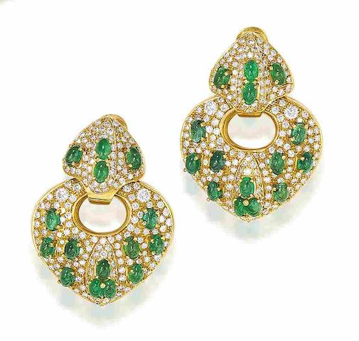 A pair of emerald and diamond pendent earrings, by Moroni