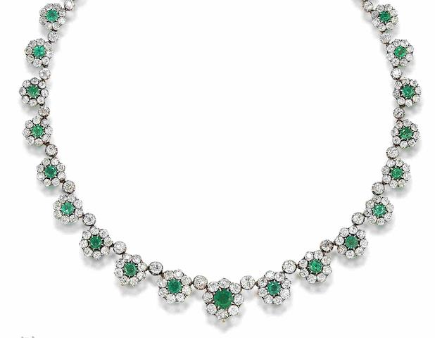 A late 19th century emerald and diamond necklace