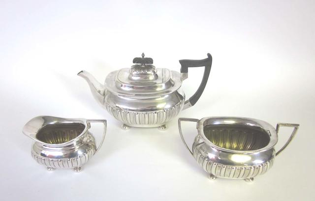 An Edwardian  silver three-piece tea set by Walker and Hall, Sheffield 1909-10  (3)