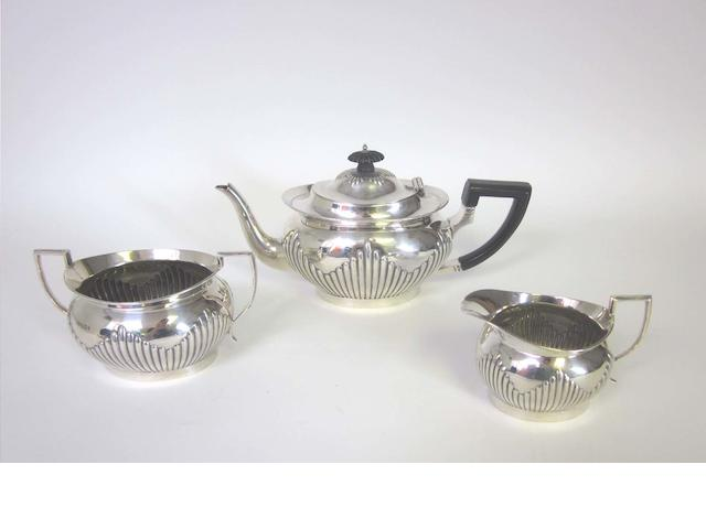 A late Victorian silver three-piece tea service by Mappin & Webb, Sheffield 1896-98  (3)
