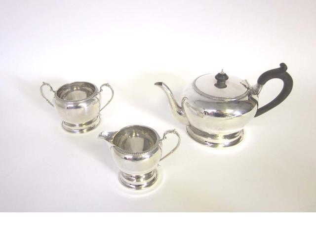 A silver three-piece tea service by Harrison Bros & Howson, Sheffield 1937 and other silver items (Qty)