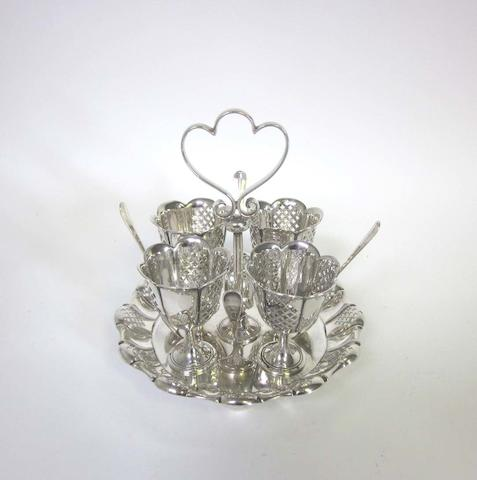 A silver egg cruet by James Dixon & Sons, Sheffield 1899 and other items