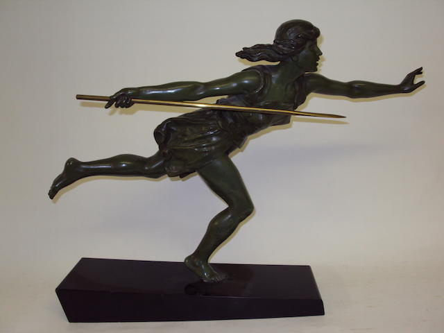 A bronze-effect figurine of a female warrior
