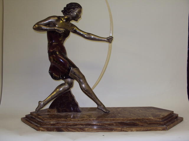 An Art Deco-style figurine of a female archer on a marble base