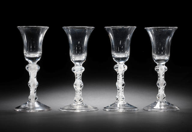 A set of four opaque-twist wine glasses, circa 1765