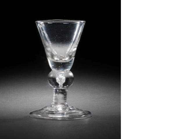 A heavy baluster wine glass, circa 1710