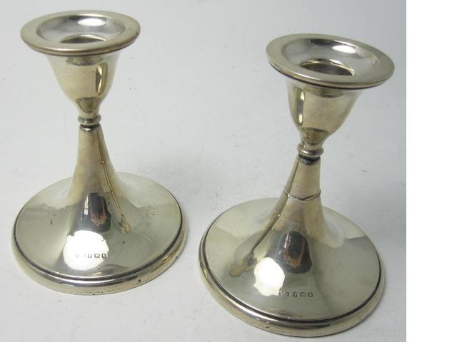 A pair of silver candlesticks Birmingham 1916