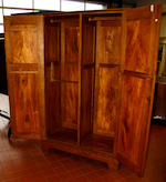 A good mid-20th century Arts & Crafts style figured oak wardrobe