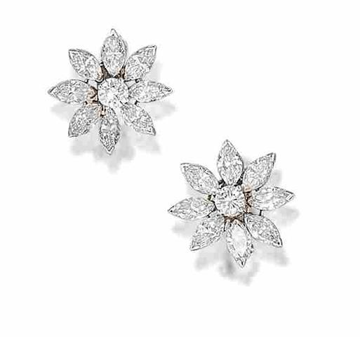 A pair of diamond cluster earclips, by Pederzani