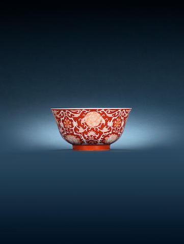 A fine coral-ground 'lotus and peony' bowl Daoguang seal mark and of the period