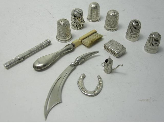 A small collection of silver novelties  (12)