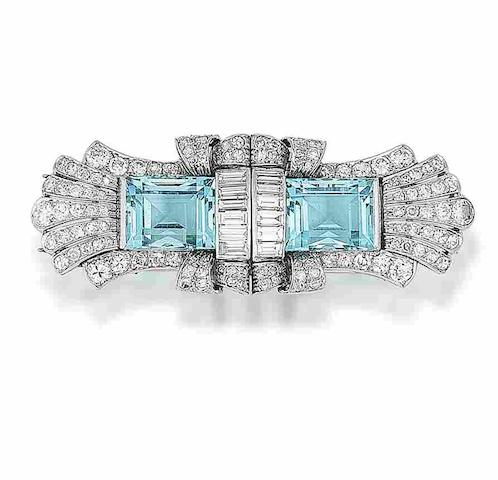 An aquamarine and diamond double-clip brooch,