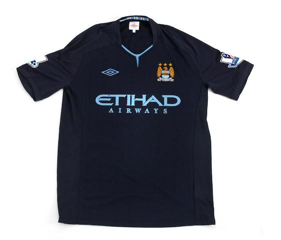 2011/12 Balotelli match worn hand signed Manchester City away shirt