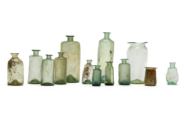 A collection of thirteen English glass apothecary bottles and phials, 17th and 18th century